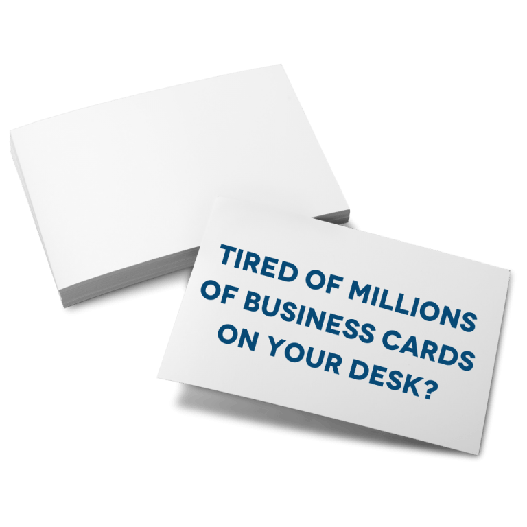 Stack of business cards saying tired of millions of business cards on your desk
