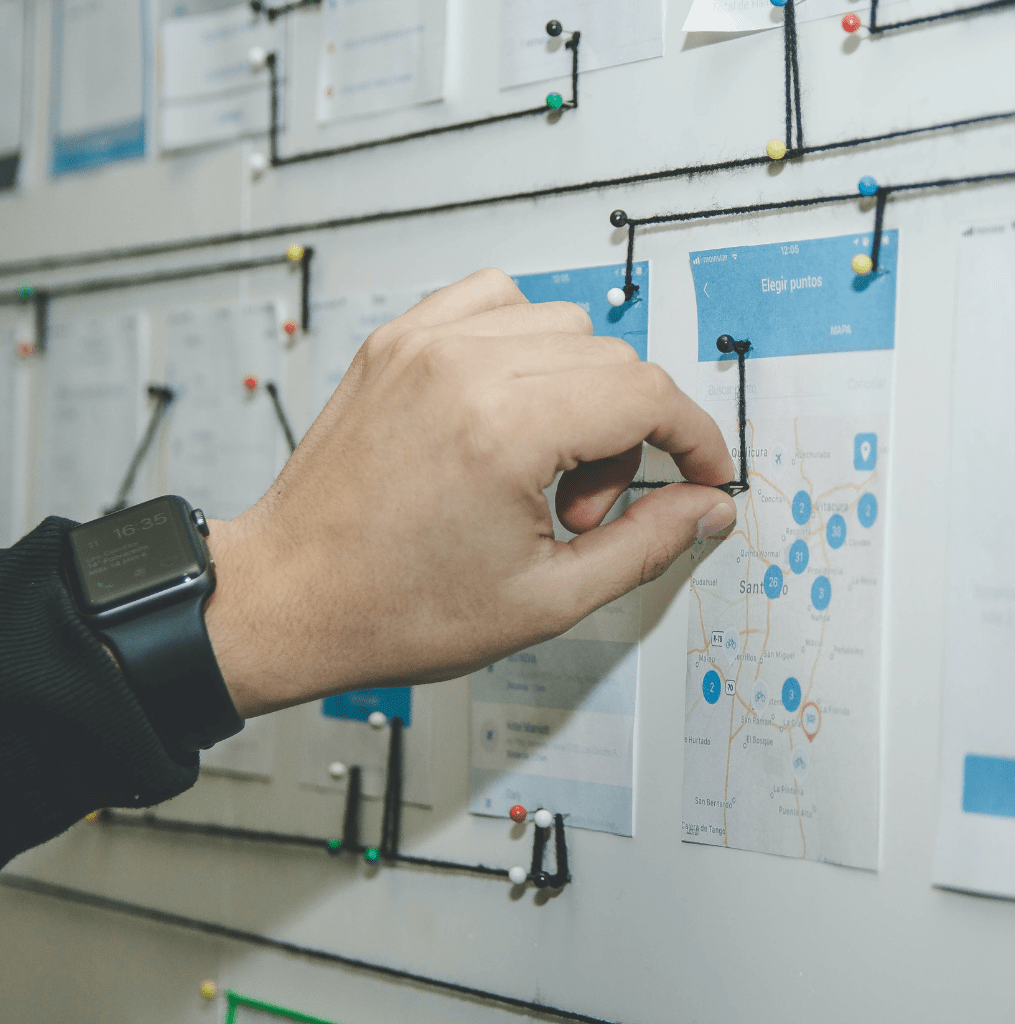 Hand looking at custom mobile app development company portfolio